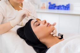 woman receiving bespoke facial at Avanti Aesthetics Clinic