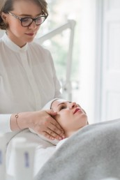 specialist preparing patient for microneedling treatment